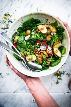 Vegan spring salad with roasted new potatoes, peas, asparagus and dill ...