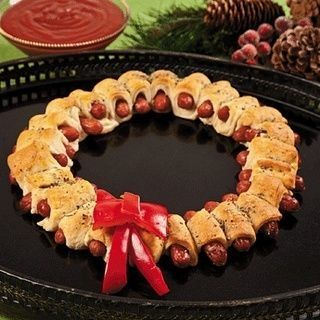 Smokey links wrapped in crescent rolls and arranged in a wreath pattern...a great appetizer/part of a main dish for a Christmas decorating party!