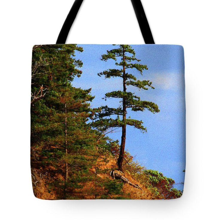 Pine Tree Along The Oregon Coast Tote Bag by Tom Janca.  The tote bag is machine washable, available in three different sizes, and includes a black strap for easy carrying on your shoulder.  All totes are available for worldwide shipping and include a money-back guarantee.