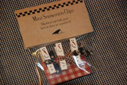 Snowmen clothespins, painted several for craft shows, added a ribbon and called it a card garland and sold them all!