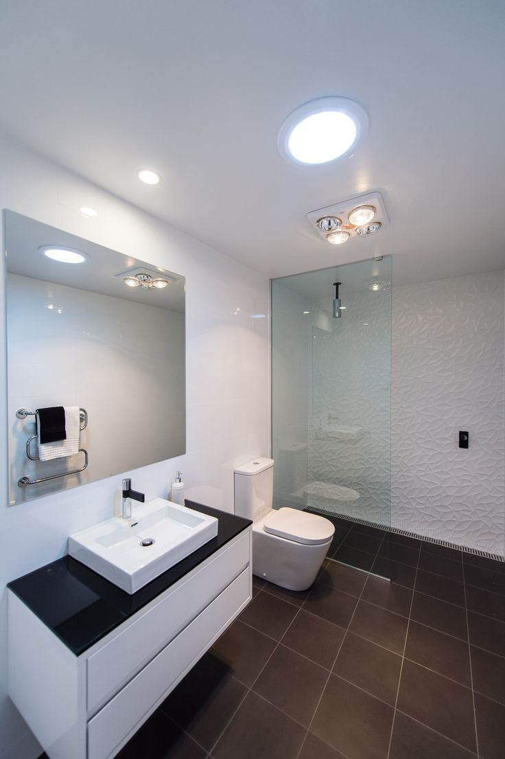 A black and white floating benchtop paired with a drop in sink and textured wall creates a beautiful combination - Manhattan Home Design - Find the floor plan at http://www.wilsonhomes.com.au/home-design/manhattan #showerideas #wilsonhomes