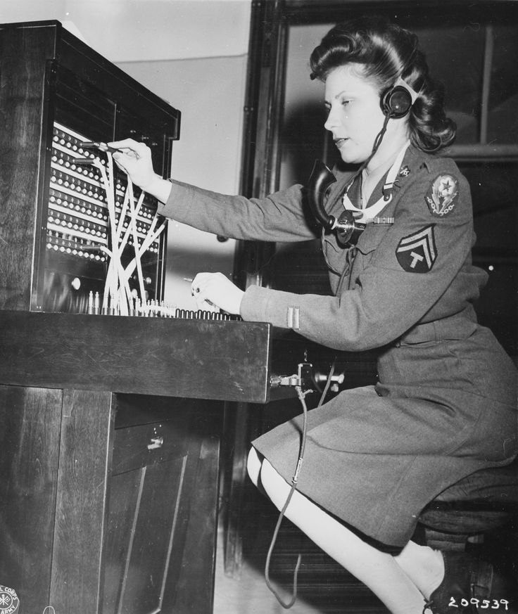 """WAC Cpl. Alma Bradley operates the switchboard at the """"Little White House,"""" the residence of President Harry S. Truman during the Potsdam Conference in Germany. 13 July 1945."""