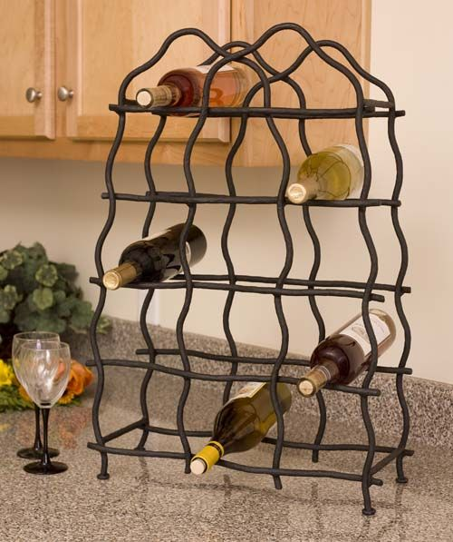 Forged Iron 14 Bottle Wine Rack Forged Iron Accessories - Hand forged iron wine rack with natural grapevine design, holds 16 bottles of your favorite wine. The black iron is blacksmith built and every hammer blow brings a specific signature of the craftsman.