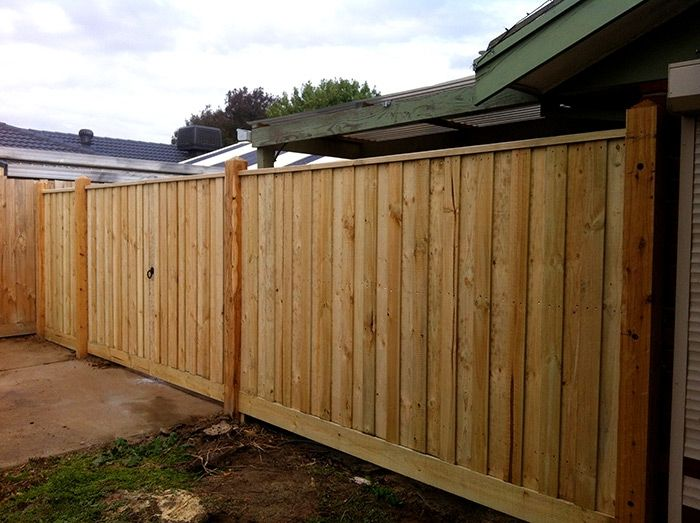 Vertical paling double driveway steel frame gate with ringlatch, drop bolts and padbolt