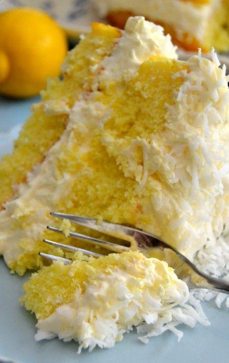 Guiltless Lemon Coconut Cake - Enjoy this spring-y, refreshing lemon coconut cake without the guilt! Smart ingredient swaps make this indulgent cake guilt-free!