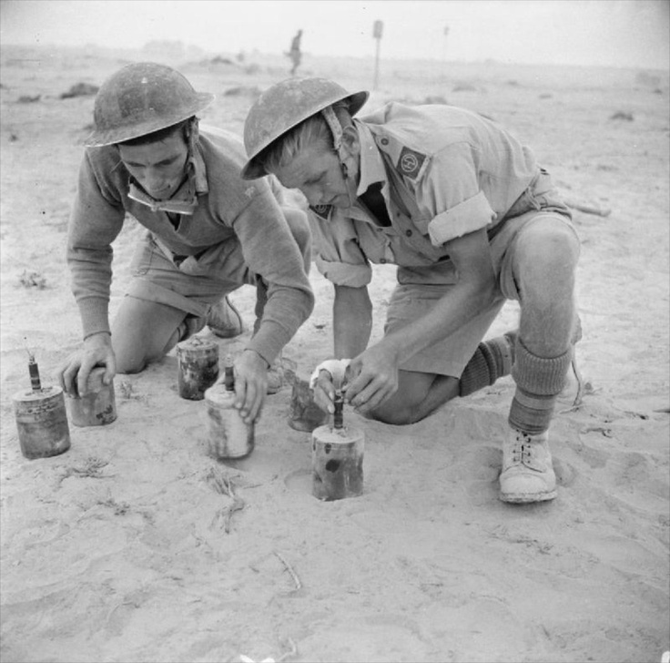 """Sappers of the Highland Division defusing German """"S"""" mines. These contain 260 pieces of shrapnel and go off under slight pressure.1942"""