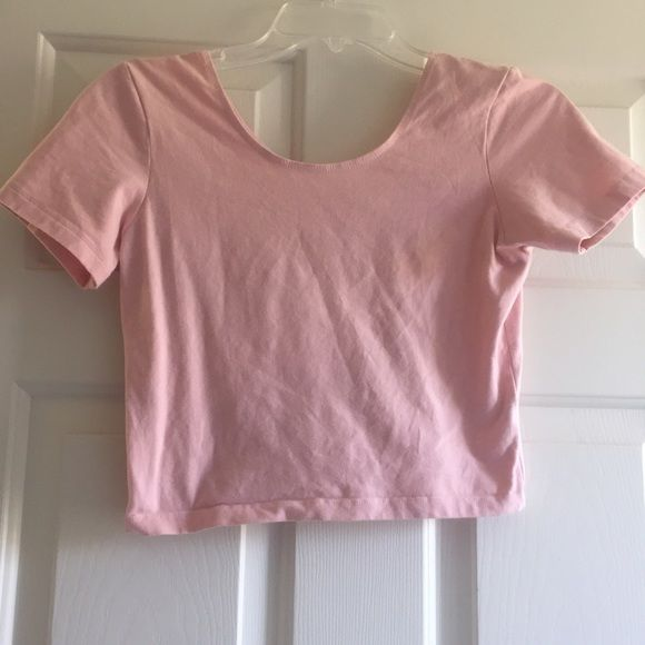 Cotton Spandex Jersey Crop Tee NWOT Baby pink crop top. This has been sitting in my closet but it has never been worn before. It is in excellent condition. Size M/L. No trades! American Apparel Tops Crop Tops
