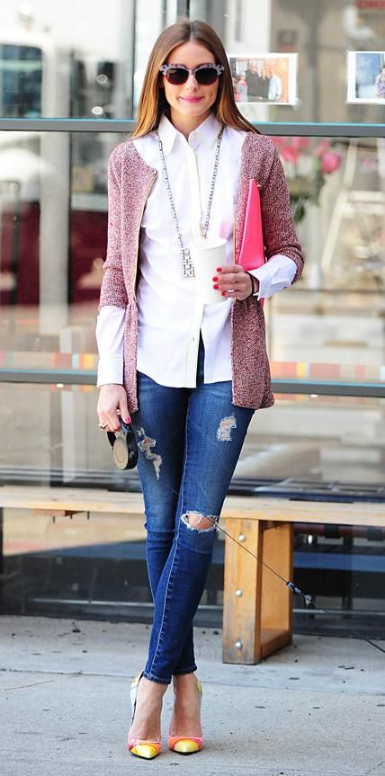 Palermo took Mr. Butler out for a walk, elevating distressed AG Jeans skinnies with a crisp white button-down layered with a pink tweed coat. Cool shades, a long chain pendant necklace, an oversize hot pink pouch, and cheery multicolored pumps completed her look.