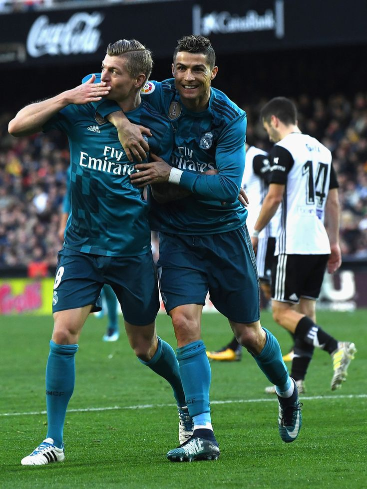 Cristiano Ronaldo Photos - Toni Kroos of Real Madrid celebrates with teammate Cristiano Ronaldo after scoring his sides fourth goal during the La Liga match between Valencia and Real Madrid at Estadio Mestalla on January 27, 2018 in Valencia, Spain. - Valencia v Real Madrid - La Liga