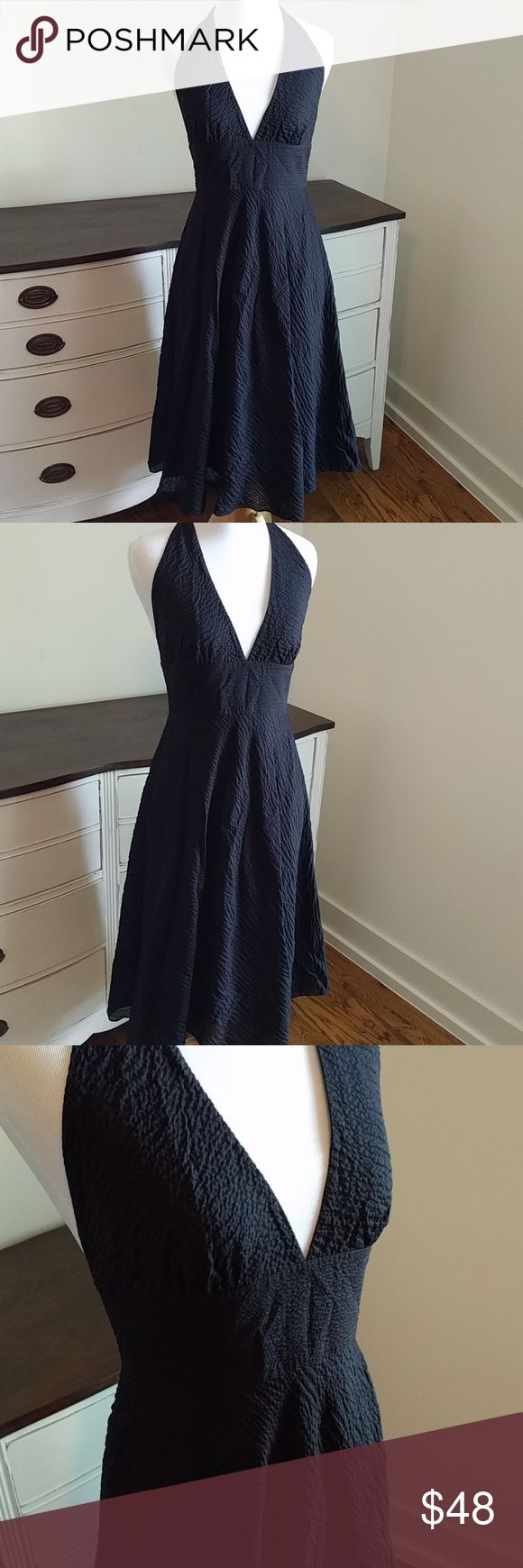 J.Crew embossed black halter dress This gorgeous J.Crew dress was tried on but never worn. Extremely versatile, can be worn sexy or cute with belts, ribbons or ties! Fully lined. Ordered from the catelog not factory or outlet. NWOT j.crew Dresses