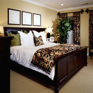 Bedroom Decorating Ideas - Decorating a Master Bedroom - Good Housekeep-love this bed and I'm really liking the white comforter with splashes of color in the throws and pillows!