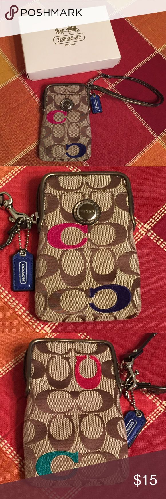 "COACH Wristlet Khaki Multicolor Signature C Print * Brand: Coach * Style: Small Wristlet * Color: Khaki with multicolor C's * Measurements: Approximately 3.25"" x 5.25"". Strap is a 6"" drop * Description: Has 3 card slots on one side & one slot on the other side. $20 bill is shown for size, not included in listing 😀 * Good preloved condition. There is a small scratch on the surface of the emblem & wear on the handle near the hang tag. The material is starting to peel away. Please see last…"
