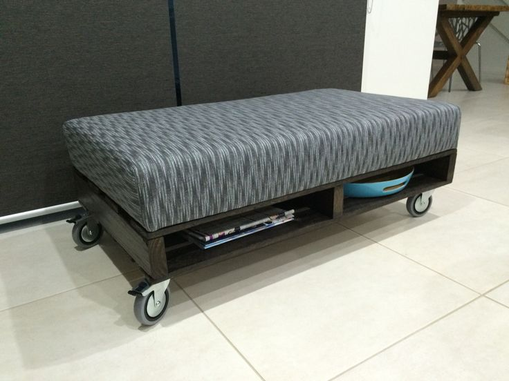 DIY Pallet Ottoman, Upholstered,  Fabric, Industrial style, on wheels.   Pretty proud of my creation :)