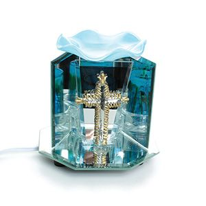 Mirror Display Oil Burner - Cross $9.95 This mirrored oil burner sets off a labyrinth of color and stunning art with a glass cross in the center. O-174 Order Here: africaimports.com #cross