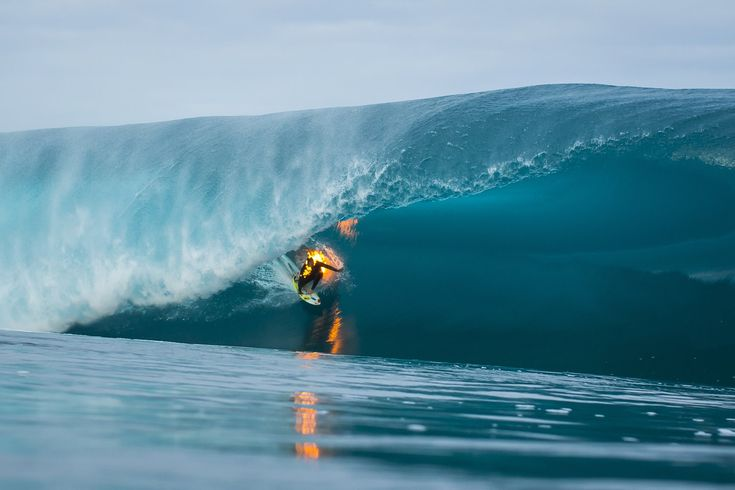 Watch Jamie O'Brien surf one of the world's heaviest waves — while lit on fire.