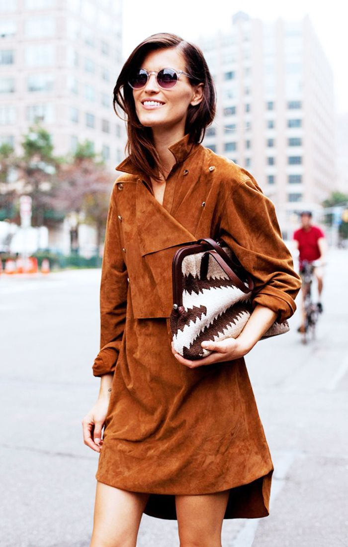 Suede wrap dress, round sunnies, and printed bag