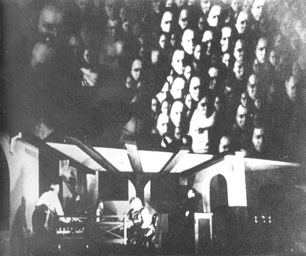 Erwin Piscator - 1926 - use of projected images behind acted scene