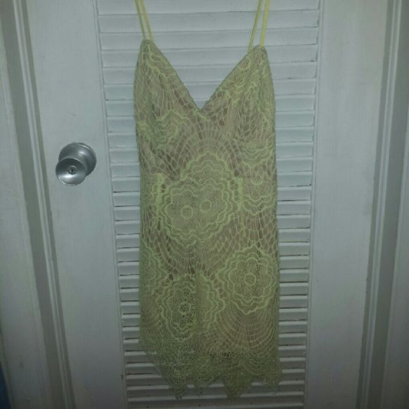 Bardot Australia Yellow Lace Romper This is a NWT yellow lace romper from Bloomingdales, in a size small. It is criss crossed in the back, and has a zipper closure. I do accept offers! Bardot Pants Jumpsuits & Rompers