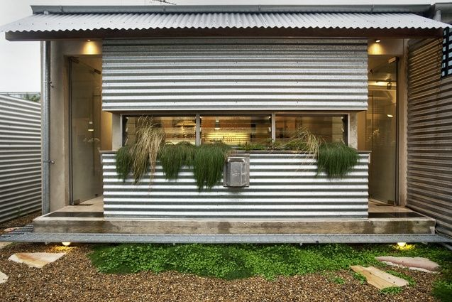 The exterior is clad in corrugated steel sheeting.