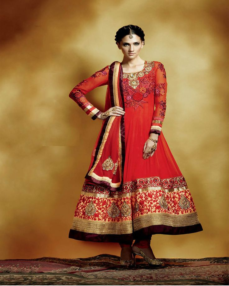 Bright red Bridal suit in 'Anarkali' style,floral embroidery in gold and gem work on neckline and broders.