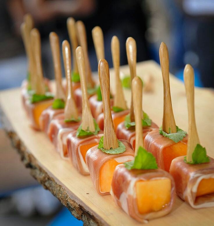 Prosciutto mellon pops.  So easy - cantaloupe wrapped in prosciutto & garnished with mint