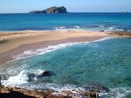 Cala Conta, South Ibiza. You may recognise this gorgeous patch of paradise as the location for Wham's Club Tropicana video featuring George Michael :)