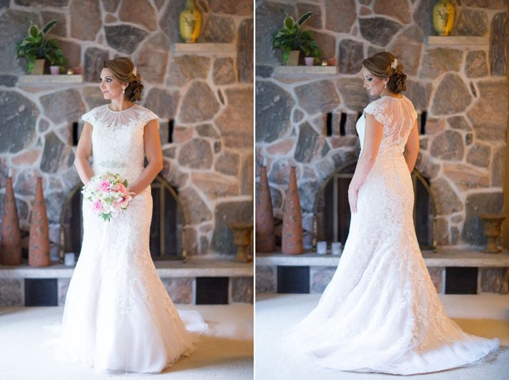 Vineland Estates bride in front of stone fireplace