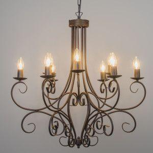 Candelabro ROMANTICA 9 óxido - Grande, robusta y atemporal lámpara clásica. Con adornos de hierro forjado, fabricada por artesanos italianos. Acabado a mano en un hermoso color rústico óxido.