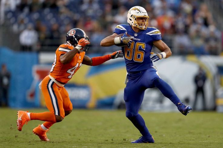 Broncos vs. Chargers:   October 13, 2016  -  21-13, Chargers   -    Hunter Henry #86 of the San Diego Chargers catches a pass as T.J. Ward #43 of the Denver Broncos defends during the first half of a game at Qualcomm Stadium on Oct. 13, 2016 in San Diego.