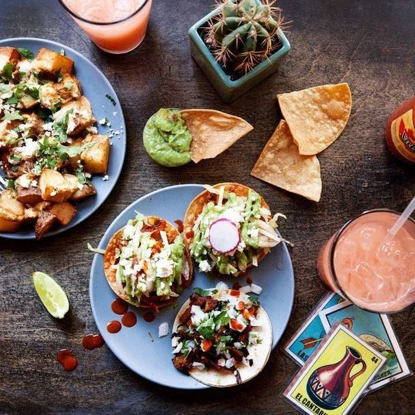 """""""Al pastor tacos, pork shoulder tostadas y papas fritasI got a little too excited when I poured the hot sauce."""" - Slice of Pai Photography 