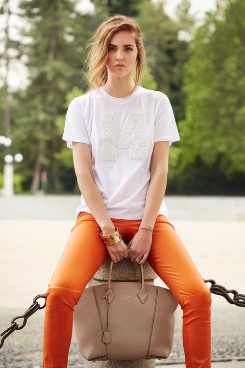 Shop this look for $442:  http://lookastic.com/women/looks/white-crew-neck-t-shirt-and-orange-skinny-pants-and-beige-tote-bag-and-gold-statement-bracelet/2770  — White Crew-neck T-shirt  — Orange Leather Skinny Pants  — Beige Leather Tote Bag  — Gold Statement Bracelet