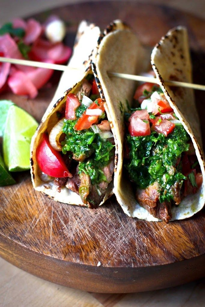 Grilled Steak Tacos with Cilantro Chimichurri Sauce....flavorful and delicious, perfect for outdoor gatherings and barbecues.   www.feastingathome.com