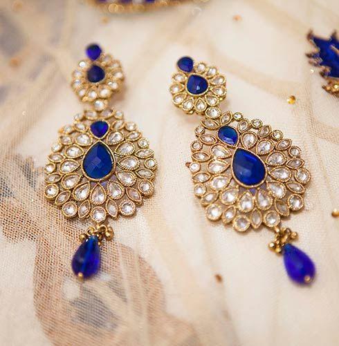 Kundan earring with royal blue drop hangings for Bride Monica Singh of WeddingSutra. Photo courtesy- Romesh Dhamija Productions
