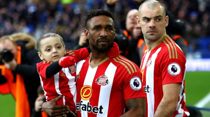 """Friends and family of the six-year-old football mascot have been encouraged to wear football shirts to help celebrate his life. England striker Jermain Defoe will join the family and friends of Bradley Lowery for the funeral of the six-year-old football mascot.  The youngster had enjoyed a close friendship with Defoe who said Bradley had been his """"best friend"""" and would continue to inspire him. The footballer is leaving a pre-season training camp in Spain with his new club Bournemouth so he…"""