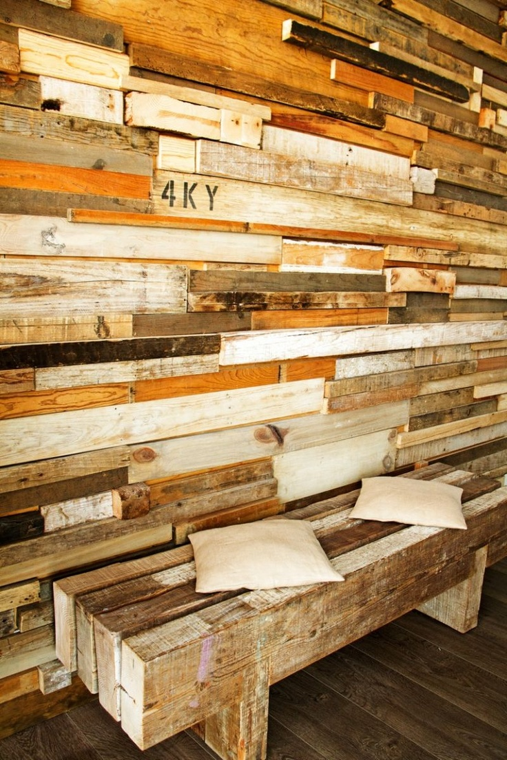 Great textured wall with different reclaimed wood boards in different stains