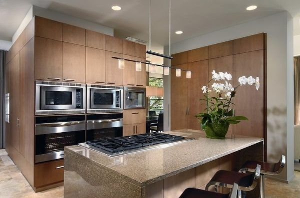 Kitchen Island Light Ideas Using Pendant Track Lighting Adapter Above 6 Burner Gas Cooktop Adhered by the Countertops from Tropic Brown Granite also Drop Down Lights Light Colored Granite Kitchen Light Bronze