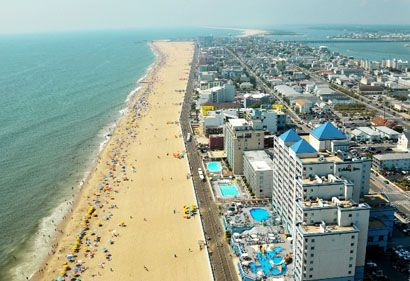 Ocean City, MD - when I was 9.  Got a pile of sand stuck in my bathing suit.  Was my first beach experience.