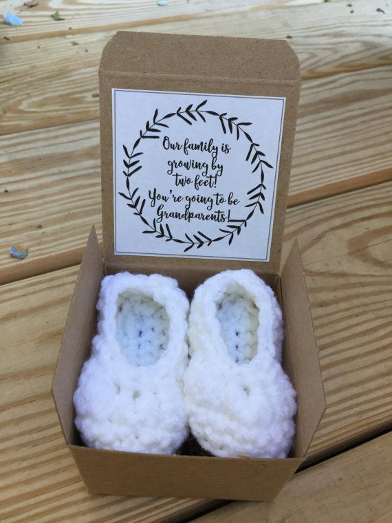 These adorable tiny baby booties will melt the hearts of your loved ones when they find out their new role. This not only announces the arrival but also becomes a gift your loved ones can use when your bundle of joy arrives.  Description: This listing is for one set of WHITE hand crocheted baby booties. As your loved one(s) open the box it will announce their new role You are going to be .....!. A sweet little satin flower can also be added. These little cuties are tucked inside a craft box…