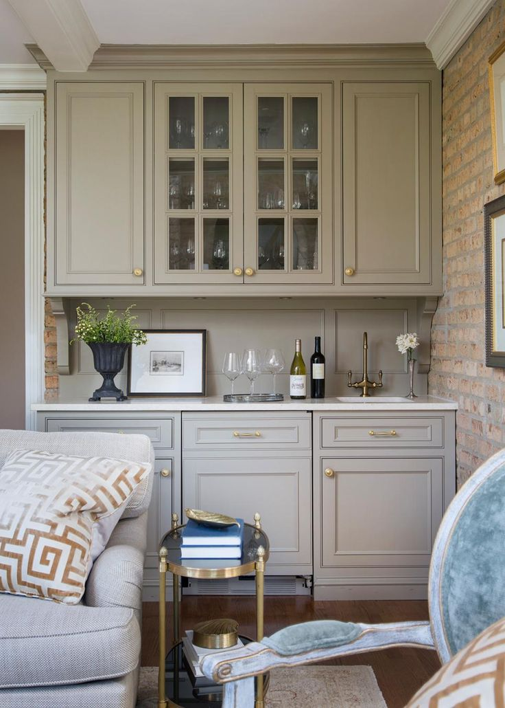 WETBAR Polished Brass Accents Add A Lovely Formal Touch To This Transitional Living Room Built In Bar Just Steps Away From The Seating Area Boasts Glass