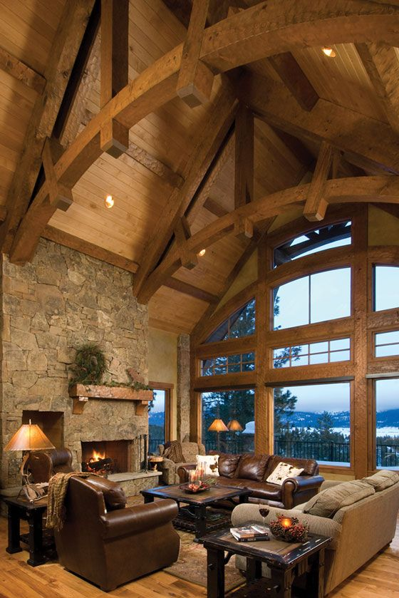 Timberframe great room by Precision Craft. The curvatures lift the eye and heighten the space considerably as opposed to traditional knee joists and straight beams.  K.W.