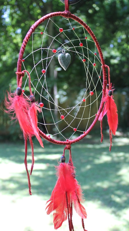 Red Hot Lovers Dream Catcher    10 inch dream catcher wrapped in red leather, decorated with red glass beads and red feathers - a silver heart pendant hangs in the center