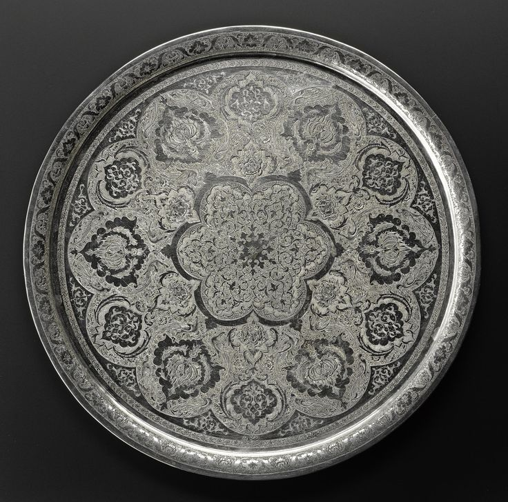 Circular tray of silver with a chased pattern of stylized floral motifs and animals, hallmarked on the front: Middle East, Iran, probably Isfahan, 1920s-1940s.