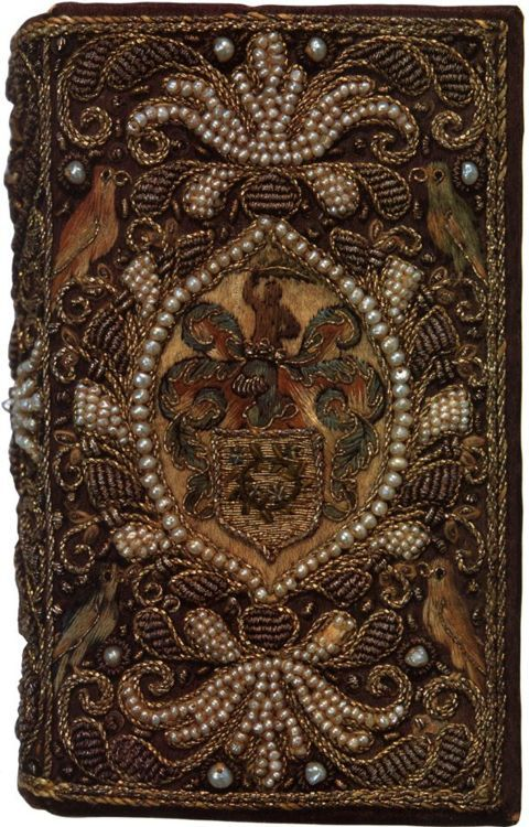 An embroidered binding in purple satin with seed pearls and bullion on a copy of The Whole Book of Psalms, London, 1641. Lessing J. Rosenwald Collection, Library of Congress. (8.2 cm. by 5 cm. by 2.5 cm)