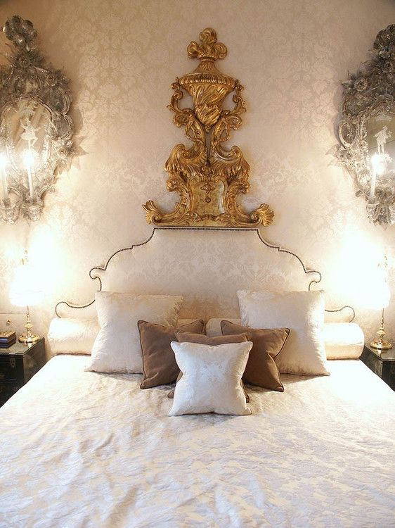 The upholstered headboard and giltwood architectural fragment make a really dramatic statement!  Coco Chanel's suite, Ritz hotel, Paris