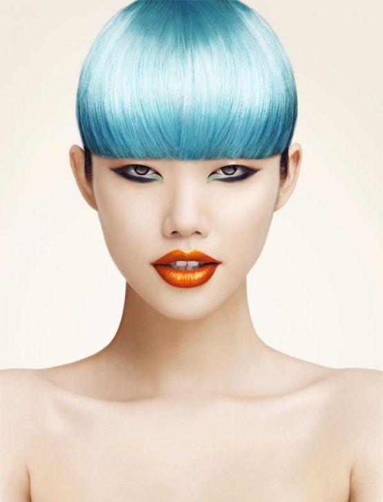 Orange lips/black and green liner. Photographer: Hai Zhen; makeup/hair: unknown