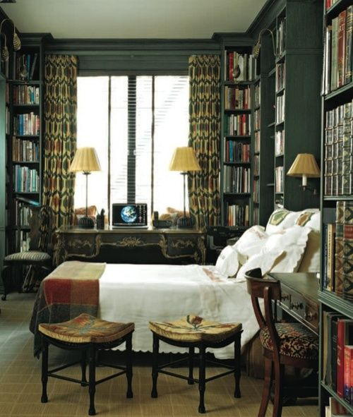 dark green walls, patterned curtains, white bed with plaid throw, and books