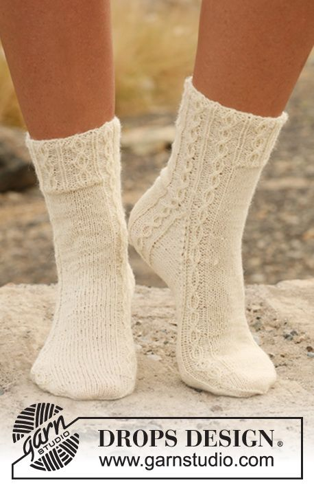 "Knitted DROPS socks with cables in ""Fabel"". ~ DROPS Design"