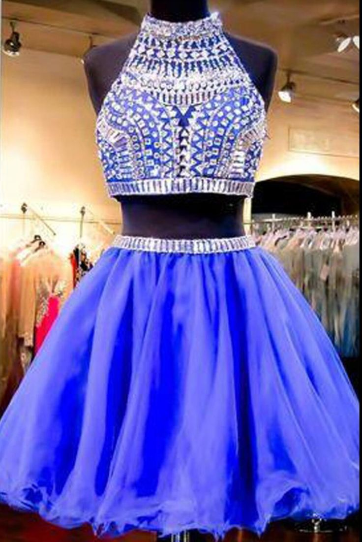 Sexy 2 pieces beaded Royal Blue short homecoming prom dresses The Sexy 2 pieces Royal Blue homecoming prom dresses are fully lined, 8 bones in the bodice, chest pad in the bust, lace up back or zipper