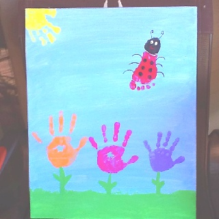 Hand and footprint art--I like the idea of putting together a spring picture