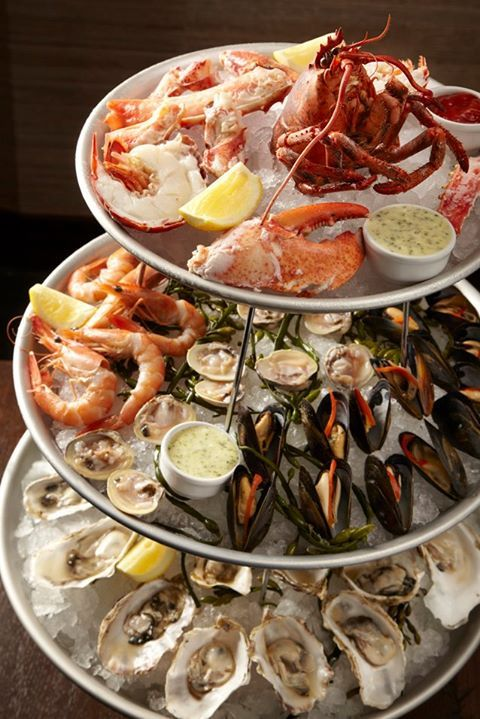 Seafood Tower at Balsan: Lobster, King Crab, Praws, Mussels, Oysters at the Waldorf Astoria Chicago.